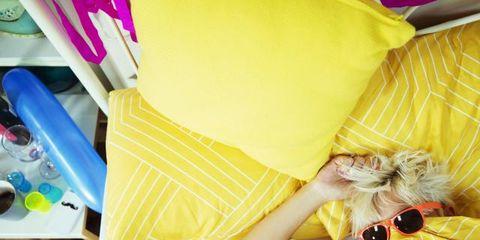 Yellow, Textile, Sunglasses, Camera, Single-lens reflex camera, Linens, Pillow, Plastic, Stuffed toy, Plaid,