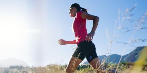 People in nature, Shorts, Grassland, Knee, Running, Jogging, Active shorts, Exercise, Sneakers, Calf,