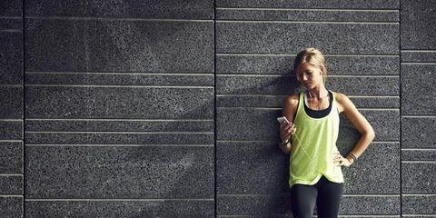 Sleeveless shirt, Standing, Active pants, Wall, Street fashion, sweatpant, Knee, Grey, Active tank, yoga pant,