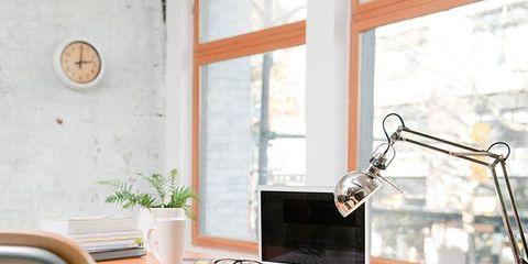 Flowerpot, Table, Room, Interior design, Display device, Computer monitor accessory, Houseplant, Computer hardware, Flat panel display, Desk,