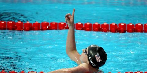 Swimming pool, Swimmer, Recreation, Fun, Endurance sports, Water, Leisure, Competition event, Red, Swim cap,