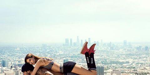 Human leg, Cityscape, Waist, Knee, Sandal, Thigh, High heels, Tower block, Sand, Skyline,