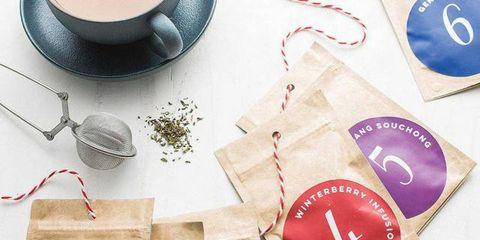 Serveware, Dishware, Carmine, Cup, Coffee cup, Kitchen utensil, Drinkware, Circle, Spoon, Label,