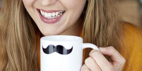 Lip, Finger, Cup, Drinkware, Mug, Tooth, Facial expression, Tableware, Brown hair, Nail,