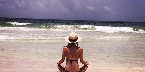 Body of water, Hat, Summer, Sun hat, Ocean, Sand, Vacation, Headgear, Beach, Shore,