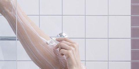 Wall, Tile, Sculpture, Composite material, Bathroom accessory, Bathtub accessory, Bathroom, Shower head, Plumbing, Square,