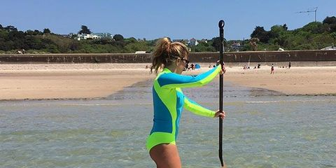 Surfing Equipment, Fun, Surfboard, Surface water sports, Sportswear, Coastal and oceanic landforms, Mammal, Boardsport, Leisure, Elbow,