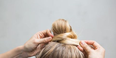 The Best Gym Hairstyles How To Do A Twisted Top Knot
