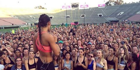 Arm, Crowd, People, Human body, Audience, Summer, Thigh, Brassiere, Sleeveless shirt, Muscle,