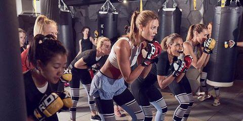 Human leg, Thigh, Team, Knee, Jersey, Choreography, Active shorts, Dancer, Knee pad, Sleeveless shirt,