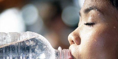 Fluid, Liquid, Lip, Skin, Bottle, Drinkware, Glass, Plastic bottle, Jaw, Drinking water,