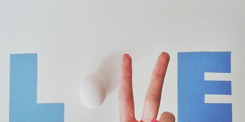 Finger, Skin, Wrist, Nail, Thumb, Gesture, Electric blue, Symbol, Square,