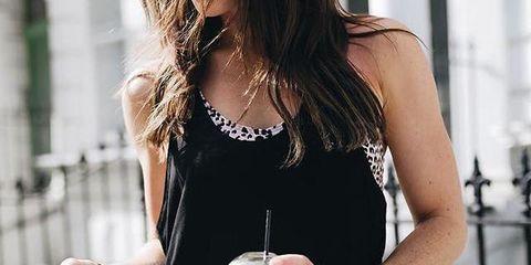 Dress, Waist, Shoulder, Neck, Drink, Sleeveless shirt, Drinking, Glass, Fashion accessory, Brown hair,