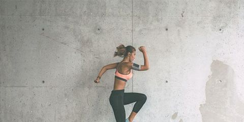 Wall, Standing, Joint, Shoulder, Footwear, Leg, Recreation, Shoe, Physical fitness, Concrete,