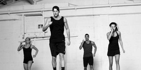 Leg, Human leg, Standing, Style, Monochrome, Knee, Active shorts, Black, Physical fitness, Calf,